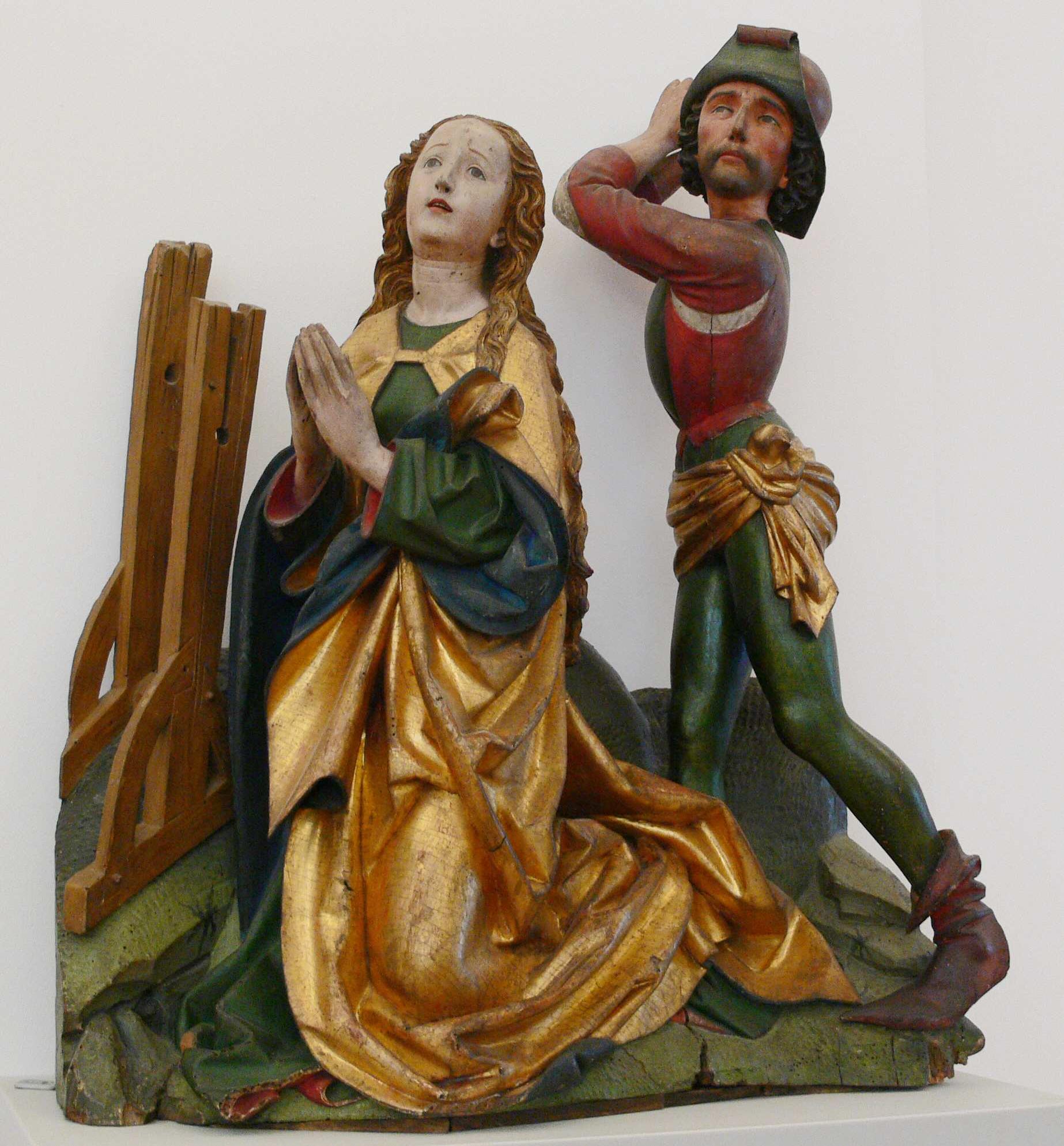 Decapitación de Santa Catalina, posiblemente procedente del retablo de la Iglesia de la Virgen en Ravensburg, ca. 1480, talla en madera. Berlín, Bodemuseum, inv. 423.
